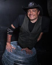 "Araon Wollin performs as ""Short E. Dangerously"" in the Hellzapoppin Circus SideShow Revue."