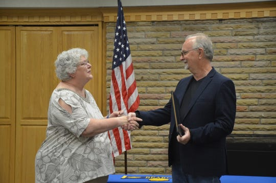 Paul Masters is greeted by School Board president Karen Evans at his diploma ceremony Tuesday.