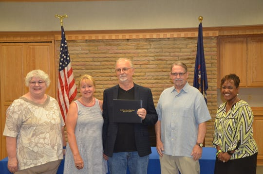 Battle Creek Public Schools honored Paul masters with his diploma on Tuesday. From left to right: Karen Evans, Lois Masters, Paul Masters, Kim Kanaga and Kimberly Carter