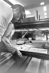 At Olin Library, a father and his baby get an up-close view of the lunar soil sample – lent by NASA – in September 1969.
