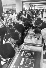 In Olin Library, September 1969, students, faculty and other observers – about 8,000 people over four days – look at moon dust returned by the Apollo 11 astronauts. Professors Thomas Gold, astronomy, and George Morrison, chemistry, both were among scientists commissioned by NASA to receive samples.