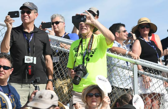 Spectators experience the launch of Apollo 11 in real time from the Banana Creek viewing site at Kennedy Space Center.