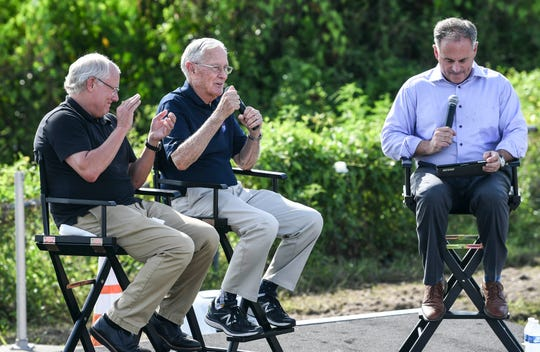 Spectators listen to recollections of the Apollo 11 launch from Andy Aldrin (son of astronaut Buzz Aldrin), astronaut Charlie Duke and CBS reporter Mark Strassmann at the Banana Creek viewing site at Kennedy Space Center.