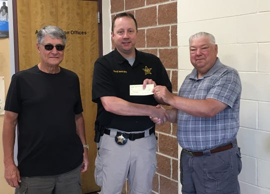 Crestline Church of Christ members present a check to Sheriff Scott Kent. The donation will be used for tactical equipment.