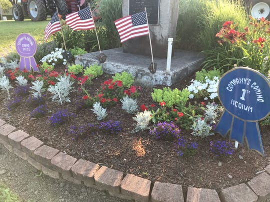 """Plots like this one at the Crawford County Fairgrounds were judged over a week ago as clubs and committees planted for the """"Company's Coming 2019"""" effort, which began almost 30 years ago. This one at the Camp Millard Memorial site placed first and then was selected Best Overall. It was planted by The Earth, Wind and Flowers Garden Club."""