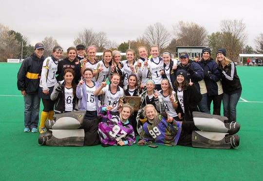 Heather Taft Garrow, far left, poses with her Essex High School field hockey team after they won the Division I title in 2013. It was Garrow's first championship as head coach.