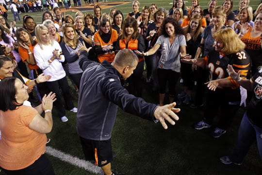 Chip Morton, Bengals strength and conditioning coach, gives a pep talk to a group of women at Football 101that supports the Marvin Lewis Community Fund Wednesday, October 21, 2015 at Paul Brown Stadium.