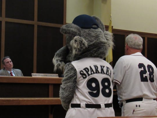 Sparkee, the Somerset Patriots mascot, and Sparky Lyle, the first manager of the Somerset Patriots, address Bridgewater Township Council President Matt Moench.