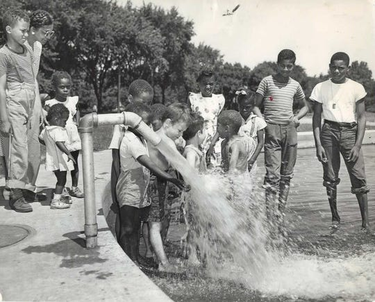 Kids cool off in the water at the newly opened Rodney Crowley Memorial playground in July, 1947.