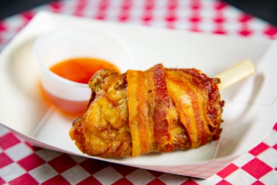 Bacon wrapped pork wing with chili sauce from Cindy's Place, one of the new foods at the 2019 Iowa State Fair photographed Tuesday, July 16, 2019.