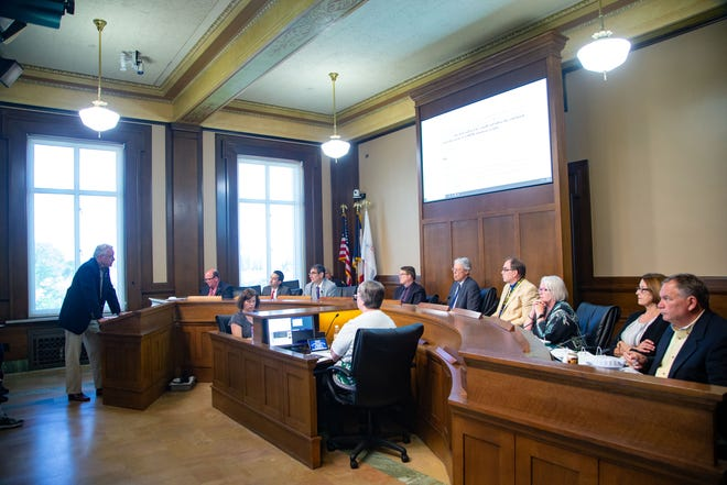 Richard Rogers of the Iowa Firearms Coalition speaks as the Des Moines City Council hears arguments on proposed restrictions on gun accessories on Monday, July 15, 2019, at City Hall. The seven-member panel eventually decided not to approve any limitations.