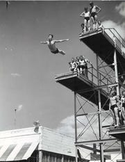 A Birdland pool swimmer takes off from the diving board in Des Moines in June, 1940.