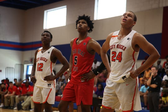 Class of 2020 point guard Caleb Love watches a teammate's free throw attempt during the 2019 Peach Invitational Tournament.