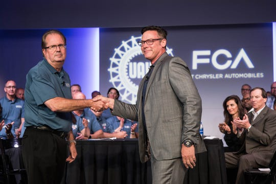 UAW president Gary Jones shakes hands with FCA North America Chief Operating Officer Mark Stewart at the FCA headquarters in Auburn Hills as the leadership teams from both sides begin contract negotiation, Tuesday, July 16, 2019.