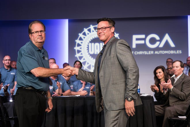 Former UAW President Gary Jones shakes hands with FCA North America Chief Operating Officer Mark Stewart at the FCA headquarters in Auburn Hills as the leadership teams from both sides began contract negotiations this summer. Jones has resigned in the midst of the federal corruption probe, and General Motors claims FCA has corrupted contract talks for years, which FCA calls meritless.