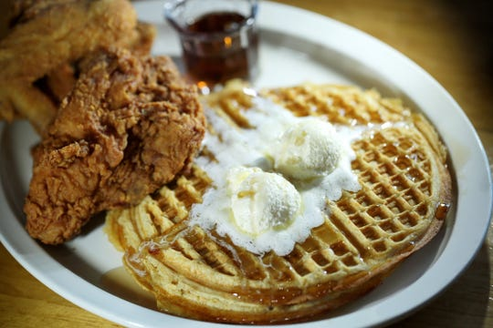 Main course of Trey-Deuce, 3 piece fried chicken and two waffles, is served during the Detroit Free Press Top 10 Takeover dinner series at Kuzzo's Chicken & Waffles in Detroit.