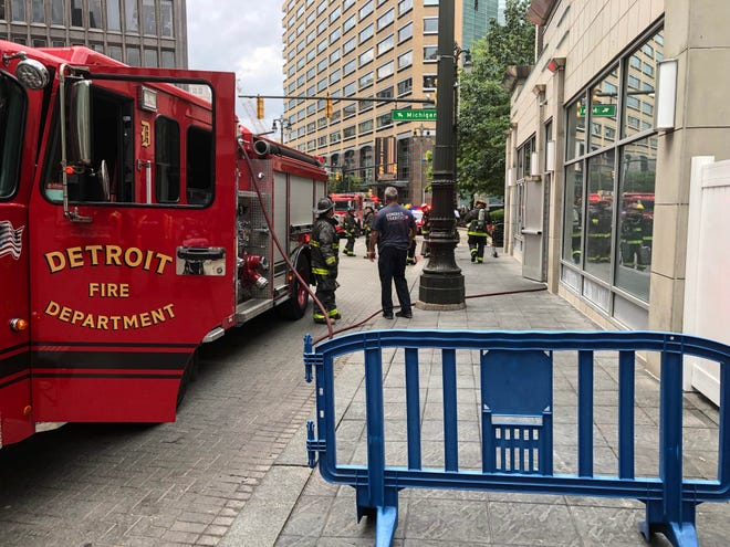 Firefighters report to scenes of a kitchen fire at Parc, a restaurant at Campus Martius in Detroit on Tuesday, July 16, 2019.
