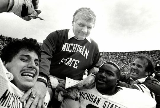 George Perles gets lifted on the shoulders of team members after a victory in 1984.
