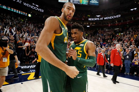 Utah Jazz center Rudy Gobert and guard Donovan Mitchell react after their win against the Milwaukee Bucks on March 2, 2019 in Salt Lake City.