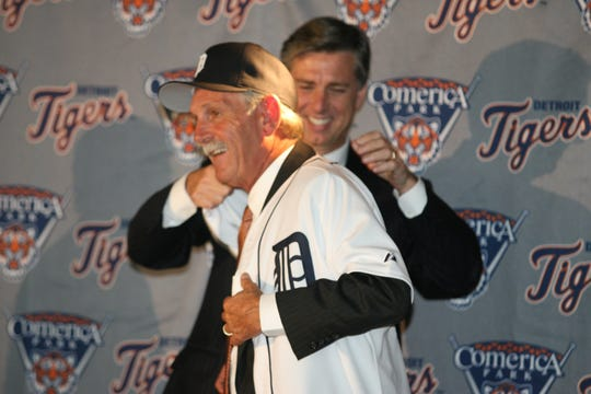 Dave Dombrowski puts Tigers joker on new manager Jim Leyland at Comerica Park, October 4, 2005.