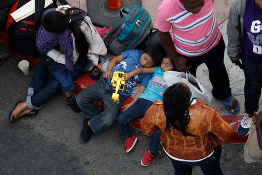 People wait to apply for asylum in the United States along the border, Tuesday, July 16, 2019, in Tijuana, Mexico.