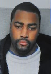 Officer Chancellor Searcy, shown during his arraignment in 2015, was charged Tuesday with two counts of misconduct in office, the Wayne County Prosecutor's Office said.
