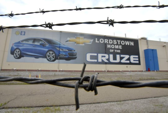 A huge billboard for the Chevy Cruze is seen on the side of the Lordstown building behind barbed wire.