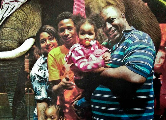 Eric Garner, right, with his children during a family outing.