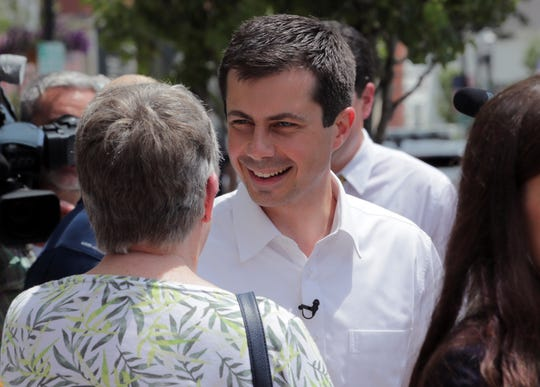 Democratic presidential candidate South Bend Mayor Pete Buttigieg listens to a woman as he campaigns, Friday, July 12, 2019, in Rochester, N.H.