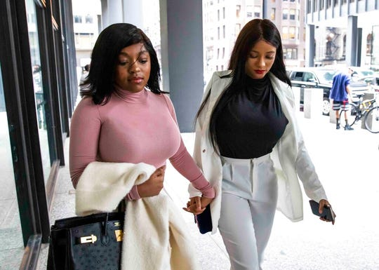 Azriel Clary, left, and Joycelyn Savage, girlfriends of R&B singer R. Kelly, walk into the Dirksen Federal Courthouse for his hearing, Tuesday afternoon, July 16, 2019.