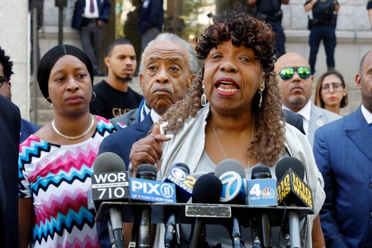 Gwen Carr, mother of chokehold victim Eric Garner, speaks outside the U.S. Attorney's office, in the Brooklyn borough of New York, Tuesday, July 16, 2019, as Rev. Al Sharpton listens, center.