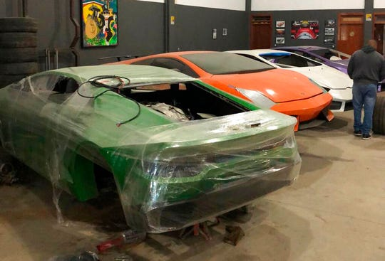 This July 15, 2019 photo released by Itajai Civil Police, shows car molds of luxury car replicas at a workshop in Itajai, Brazil. Brazilian police dismantled a clandestine workshop run by a father and son who assembled fake Ferraris and Lamborghinis to order, in Brazil's southern state of Santa Catarina.