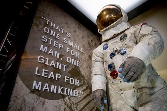 Neil Armstrong's Apollo 11 spacesuit is unveiled at the Smithsonian's National Air and Space Museum on the National Mall in Washington, Tuesday, July 16, 2019.