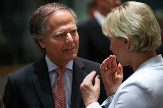 Italian Foreign Minister Enzo Moavero Milanesi, left, talks to Sweden's Foreign Minister Margot Wallstrom during an European Foreign Affairs Ministers meeting at the European Council headquarters in Brussels, Monday.