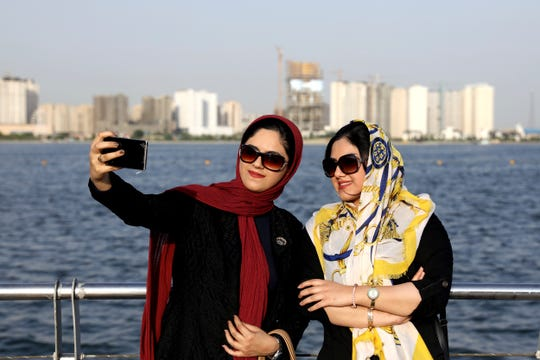 Iranians take a selfie July 7 at the Persian Gulf Martyrs lake, west of Tehran, Iran.