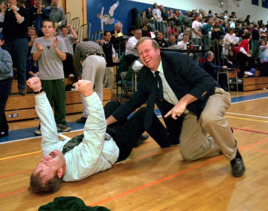 Pudge Breitwise, left, and Bill Hopkins celebrate Corning West's 55-50 win over Peekskill in a state Class B quarterfinal game in 1998 at Elmira Free Academy. Hopkins was an assistant for Breitwise that season.