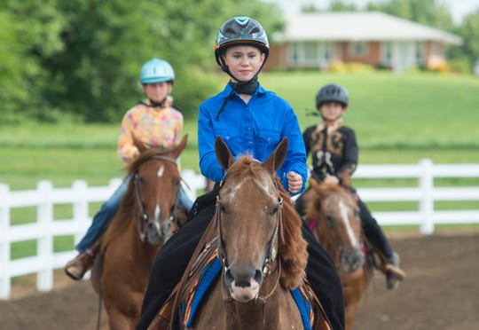 Sawyer Kelley, 11, and her horse Penny, participate in the Junior Walk-Trot Exhibition during the Warrick 4-H Fair Horse Performance classes Tuesday, July 16, 2019. Kelley received the first place ribbon.
