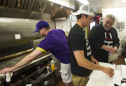 As 11:11 Burgers & Beignets opened its first location in 2015, Ryonen and Tom Faris were pictured portioning out an order of beignets, as Adam Wagner wiped down the flat top.