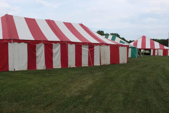 The 50th Annual Sacred Heart Parish Summerfest returns this weekend, with a full slate of events scheduled for Friday, Saturday and Sunday at the Fremont church. Volunteers  put up tents and made final preparations for the festival Monday night.
