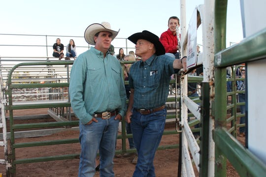 Jeremy Sturgis, left, talks with John Tillotson before Sturgis' son, Jaren, competes at Laramie Jubilee Days junior bull riding competition. Tillotson taught Sturgis how to ride bulls when he was a kid. Tillotson taught Jaren, too.