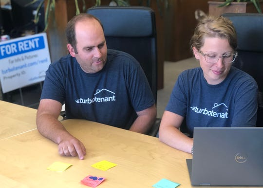 Project manager Sarah McTate and TurboTenant founder and CEO Sarnen Steinbarth look over the company's website.