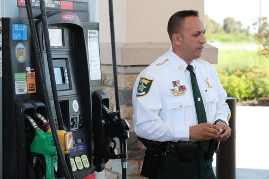 Lee County Sheriff Carmine Marceno, and members of the Economic Crimes Unit put a sticker on the gas pumps at the Racetrack gas station at Metro and Six Mile Cypress. This is letting customers know the pumps are up to date on security and no skimmers have been found.