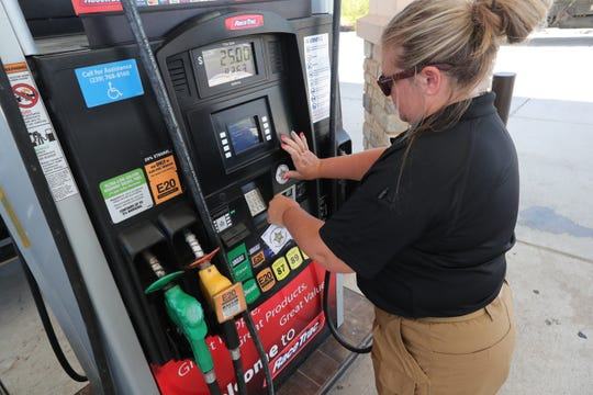 Detective Amber Flint, with the Lee County Sheriff Economic Crimes Unit, puts a sticker on the gas pumps at the Racetrack gas station at Metro and Six Mile Cypress. This is letting customers know the pumps are up to date on security and no skimmers have been found.