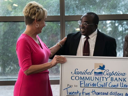 Beth Countryman, left, greets Dr. Peter Ndiang'ui after Sanibel Captiva Community Bank donated $25,000 to the Florida Gulf Coast University's College of Education on Tuesday, July 16, 2019, at FGCU.