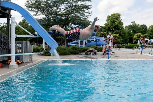 Kevin Osborn does a belly flop off the diving board at the Joannes Aquatic Center Tuesday, July 16, 2019, in Green Bay, Wis.