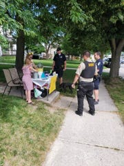 Sheboygan county officers wait in line for their lemonade.