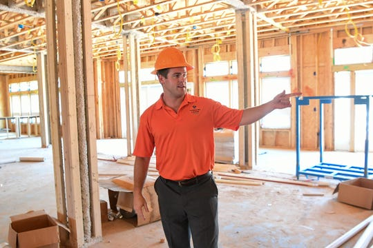 Sales manager Russell Mudge shows the first floor lounge area at the construction site for Lakeside Lodge of Clemson in July. The 118 unit condominium complex is located just over the Seneca River in Seneca next to Hartwell Village Shopping Center in Seneca, is expected to open in November.