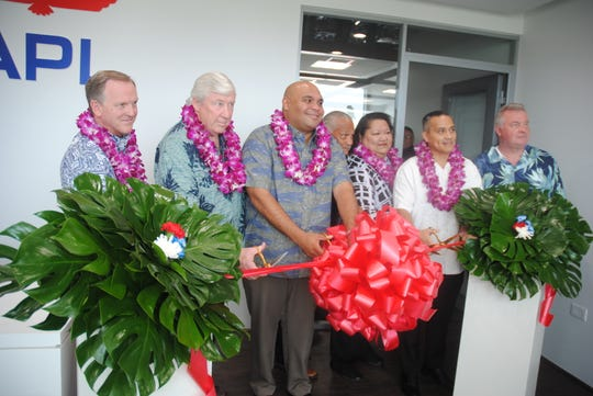 Lt. Gov. Joshua Tenorio joins APL officials at the opening  of the shipping company's new Tamuning offices