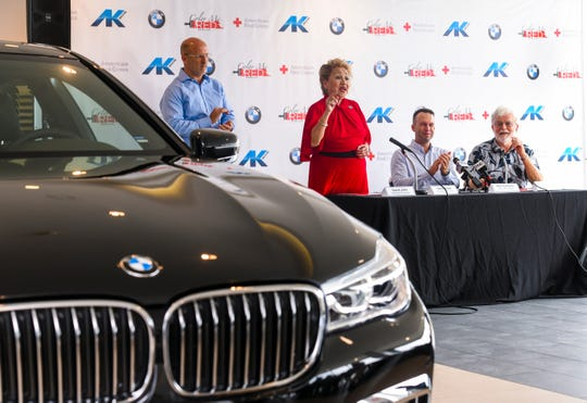 Chita Blaise, center, American Red Cross Guam Chapter executive director, introduces members of her staff as they are applauded by, from left: Red Ball chairman David John; Atkins Kroll Inc. President Alex Hammet and Jeff Cook, Red Cross member, during a press conference at the AK BMW showroom in Tamuning  July 16, 2019.
