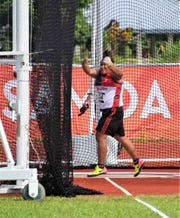 Genie Gerardo's grip on the hammer slipped, and the ball and chain get away from her during her third and final throw at the Pacific Games July 16 in Samoa.